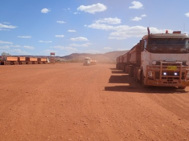 An endless procession of mining roadtrains cause the dust clouds