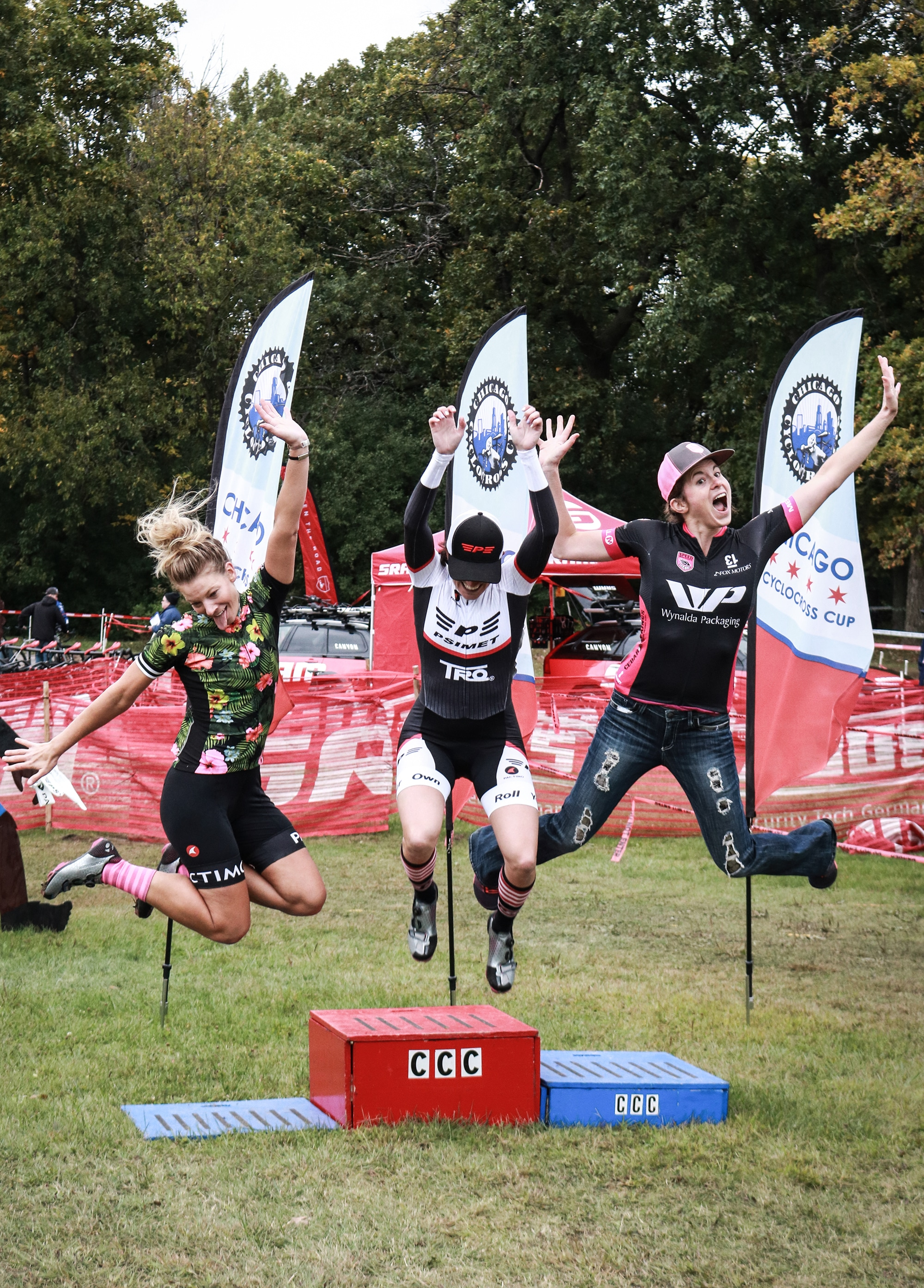 Women jumping from podium