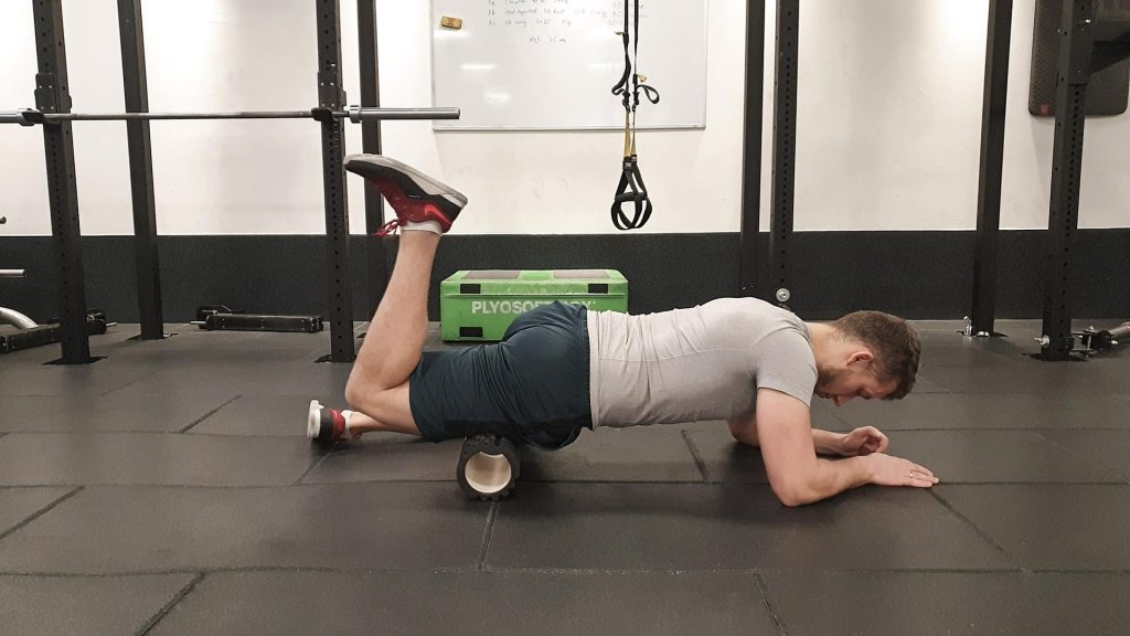 Using foam roller on legs