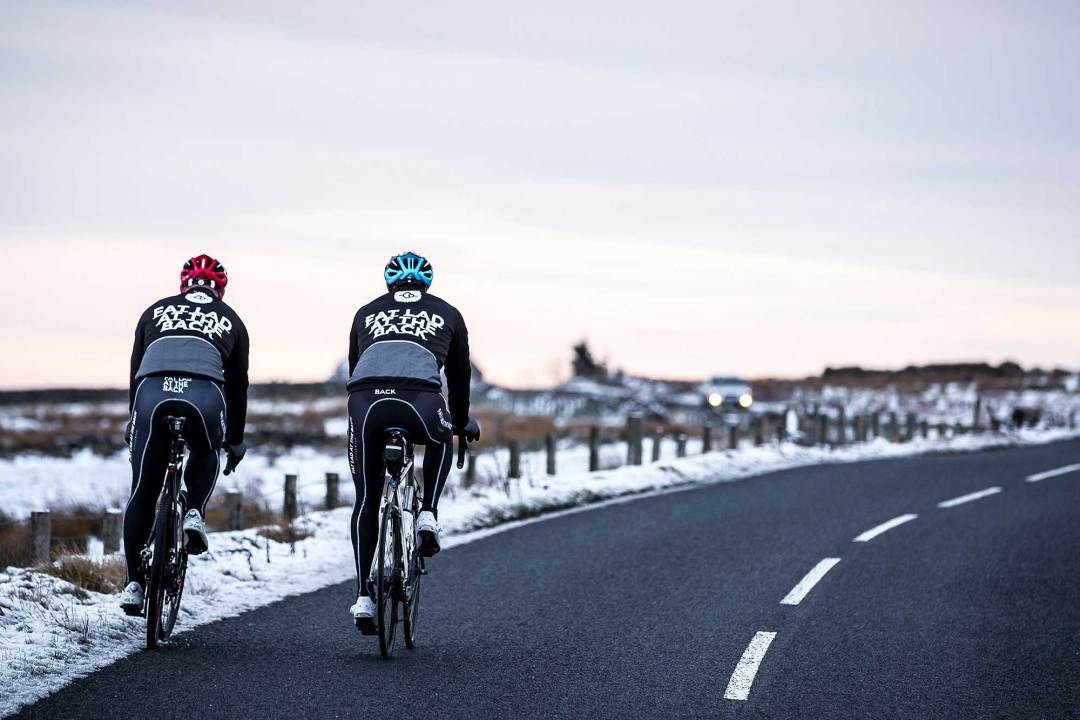 2 cyclists riding in cold weather