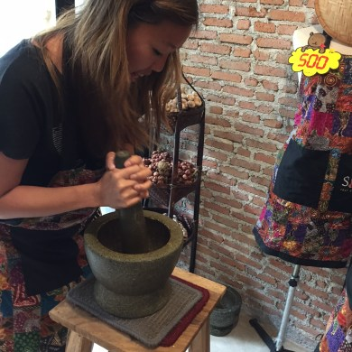 Silom Thai Cooking School - grinding the peppers