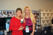 Nancy Jones with Cyndie Wade holding her custom wine glass of George Jones.