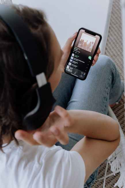 person hearing music on a smartphone