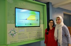 Grade 11 Prince Andrew High School students Sara Sheydaei and Fatemeh Saadat at the school's energy dashboard showing by 11:15 a.m. on Wed. Oct. 8 the school has already used enough water to fill 43 bathtubs. (L-R)