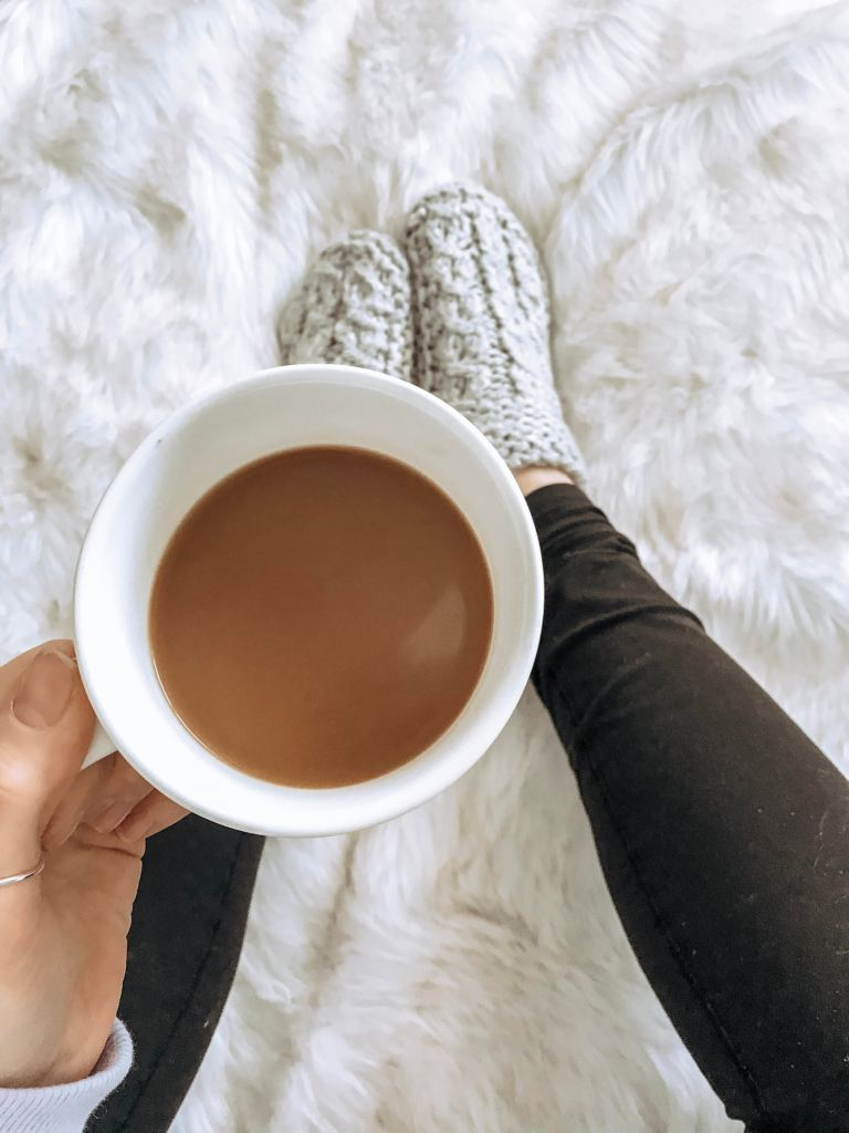 coffee and cozy slippers on a fur rug. Leggings. How to use twitter to network as a blogger!