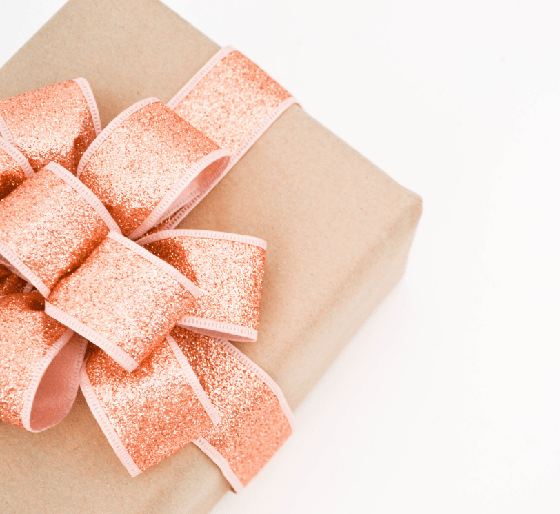 pink gift brown wrapping paper, pink sparkly ribbon