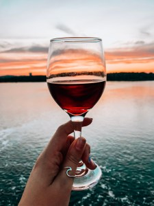 Tavern on the Falls Ottawa. Ottawa Canada. Wine glass with red wine. Waterfront patio.