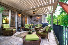 Remote controlled covered pergola w/ deluxe outdoor lighting.