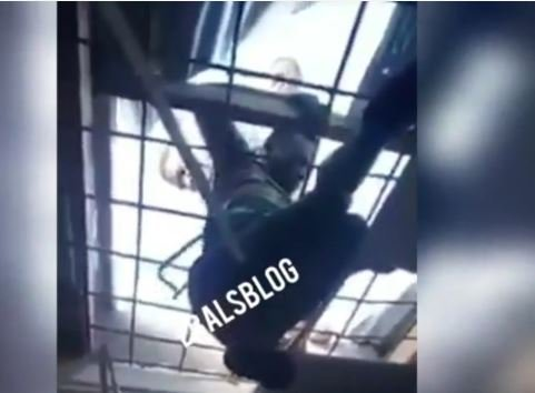 Man who tried entering a shop from the rooftop to steal Tv sets and other gadgets get stuck on the rooftop until the store owners arrived the store, rescues him and then handed him over to the security. See More Photos Below: