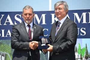 GAU Chancellor, Serhat Akpinar presents to theTurkish Ambassador