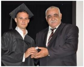 Gurkan Kara makes an award