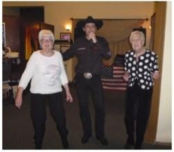 Carole (left) and Brenda (right) dancing with Devon