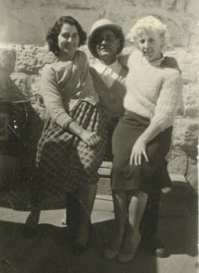 Sermens dad with his wife Gulten and Mrs Arcihbald sitting on his lap