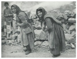 Women carrying rocks