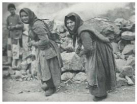 Women carrying rocks