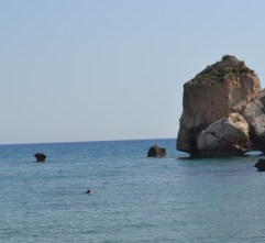 Aphrodite's Rocks with someone swimming ashore.