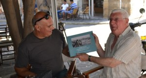 Richard shows the film crew his new book