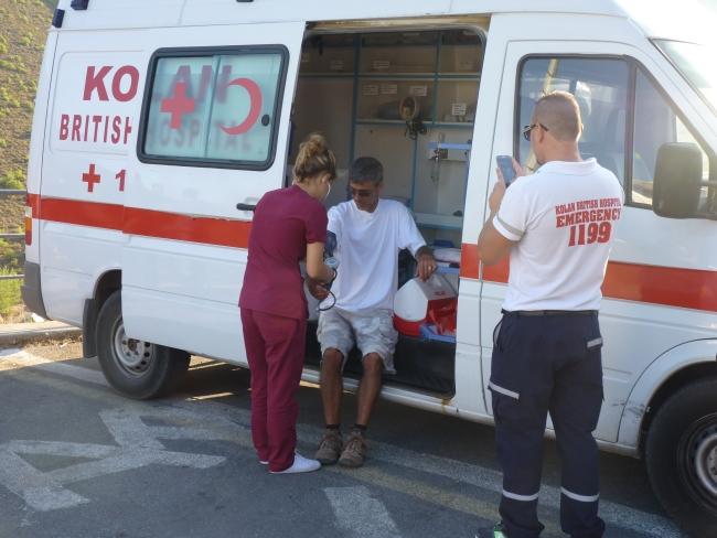Kolan British Ambulance checks out feet and blood pressures