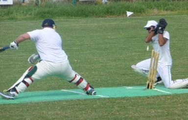 Razor sharp TRNC wicket keeper Danish Afridi, whips the bails off before Mike Roberts' foot can get back