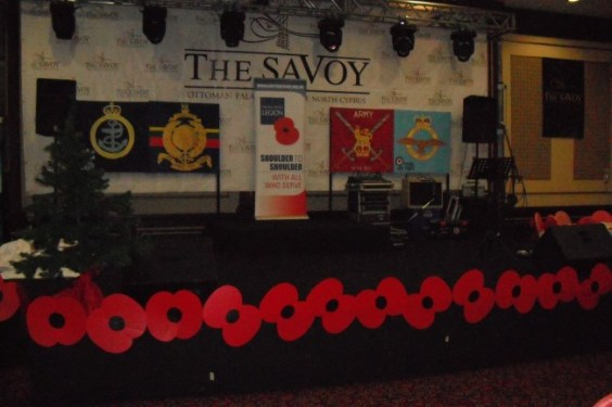 Service badges adorn the stage
