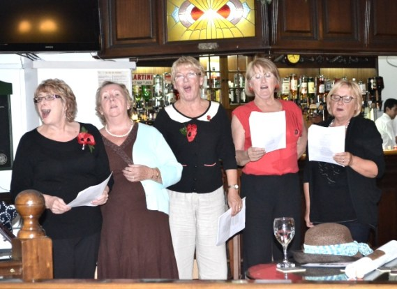 The Legionettes urging everyone to sing