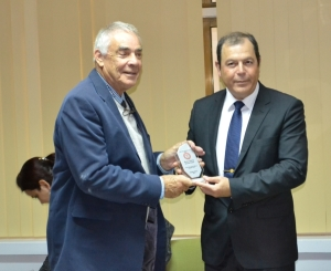 Malcom Mitcheson is congratulated by TRNC MInister of Health, Dr. Ahmet Gülle