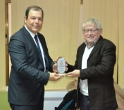TRNC MInister of Health Dr. Ahmet Gülle congratulates Mike Plant