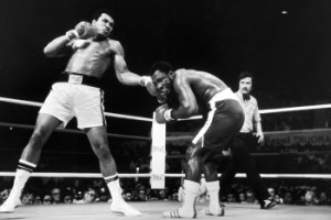 Ali catches Frazier with a punishing left. 1975