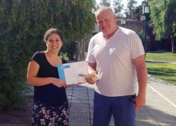 Siren Damlden present Lee Hickins with a certificate
