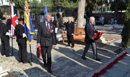 Les Smith (right) lays a wreath