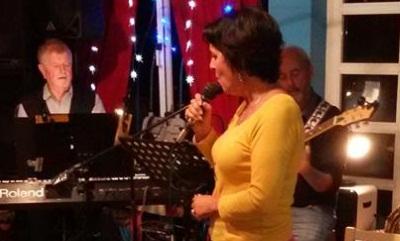 Lou singing with John and Bob