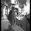 Old tramp outside Spitfire Cabaret