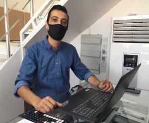 Kemal at work on my Laptop