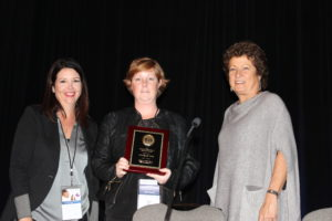 Awards Committee Co-Chairs, Eleanor Fish and Jennifer Towne present the 2016 Christina Fleischmann Award to Michelle Tate.