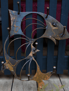 patina wall mount functional sculpture by artist and inventor John Czegledi