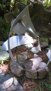 a stainless metal abstract sculpture created from scrap metal by artist and designer John Czegledi from Courtenay BC