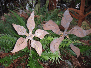 Patina metal flowers by artist, designer and inventor John Czegledi