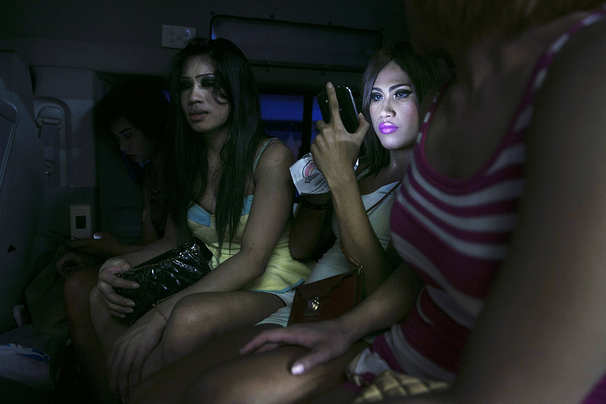 Transsexuals suspected of being prostitutes are driven to the police station