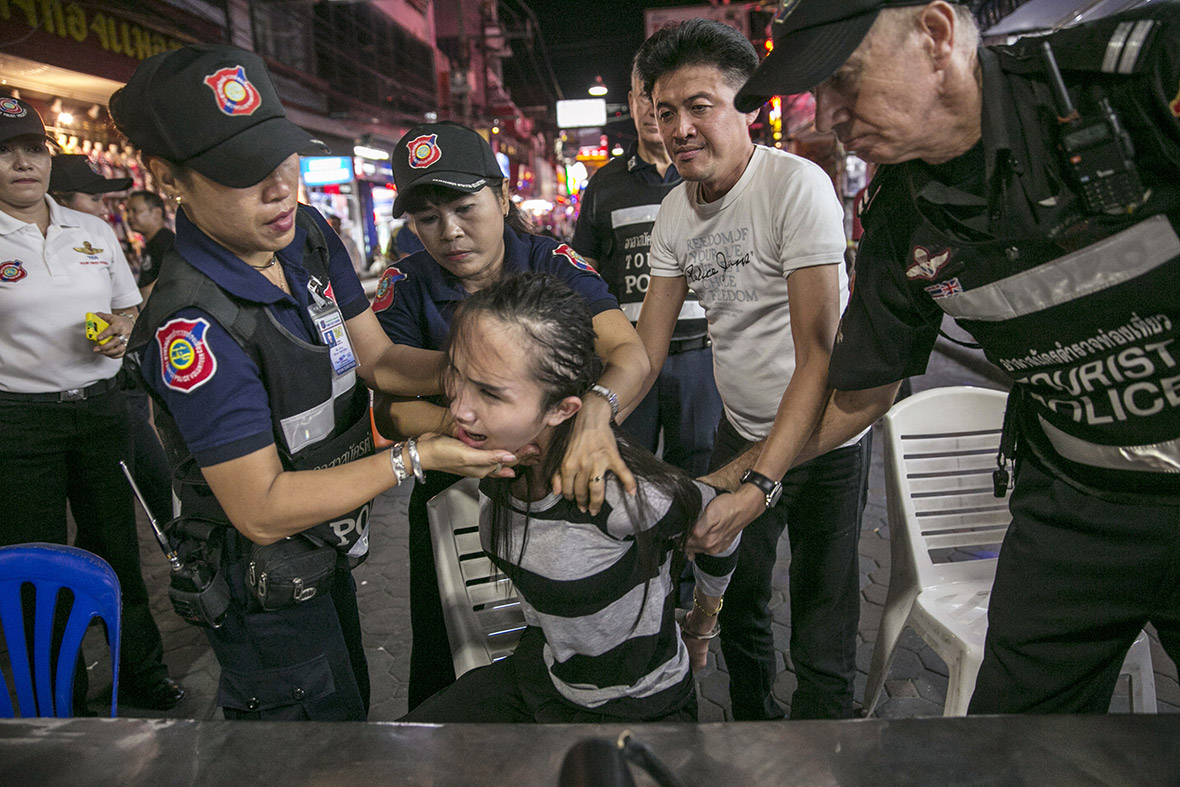A transsexual woman from Laos is round up by police after being caught allegedly stealing money from a foreign client