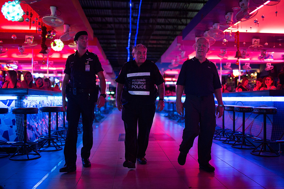 Members of the tourist police patrol a bar area near Walking Street, Pattaya's main nightlife area. The Foreign Tourist Police Assistants (FTPA) of Pattaya is a volunteer organisation providing assistance to visitors who have fallen victim to petty crime, as well as helping the Thai police deal with foreigners suspected of illegal activities