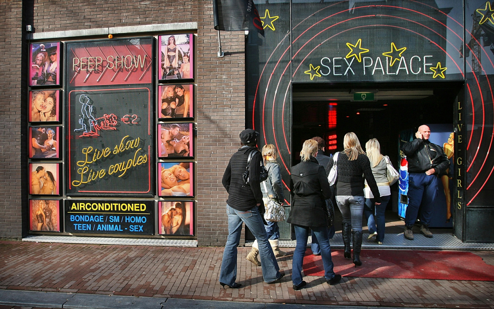 Visitors enter a peep-show theatre during the first-ever open day of Amsterdam's red light district