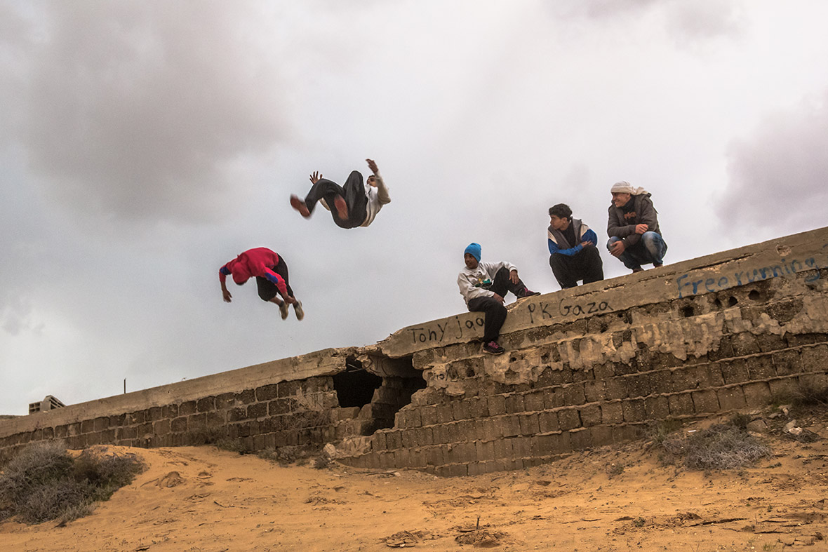 gaza strip blitzed caged and broken palestinians nightmarish palestinian youths practise parkour moves on a bombarded structure in beit hanoun
