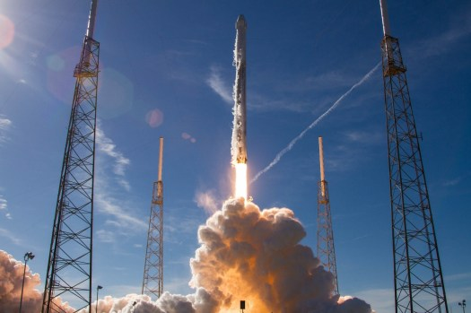 SpaceX fires up rocket that will carry the first two ...