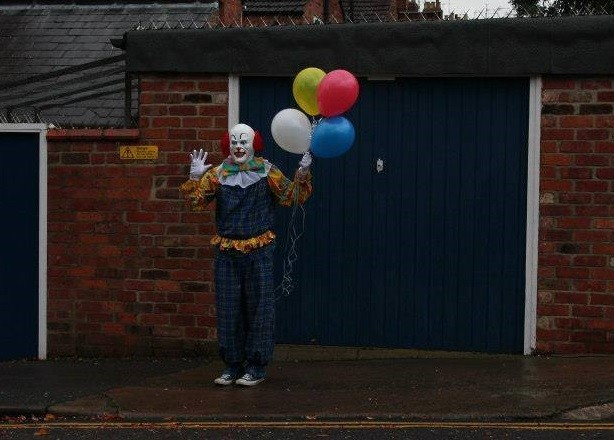 Pennywise Clown Holding Balloons
