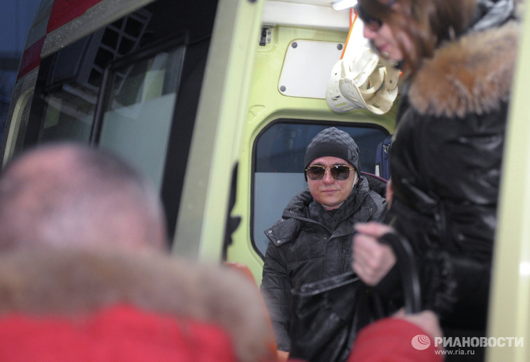 Sergei Filin sits in the ambulance after being discharged from the 36th hospital