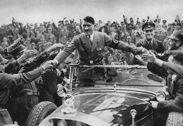 Hitler in a car rallying people towards his vision of the world back in Nazi Germany, proof of his charismatic leadership