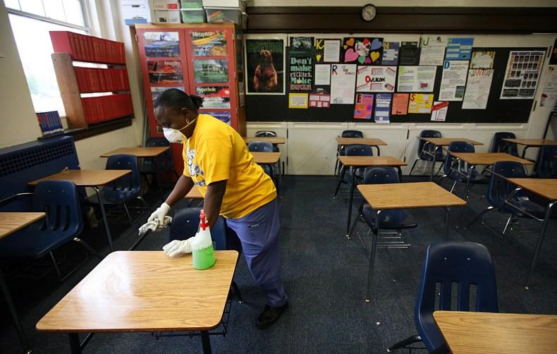 unmasked teacher breathes on student