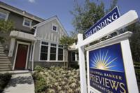 AP - FILE - In this July 24, 2009 file photo, a pending home sale in Palo Alto, Calif., is ...