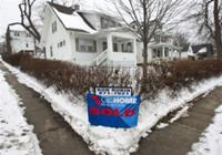 AP - FILE - In this Dec. 22, 2009 file photo, a sign proclaiming the house sold is seen in ...