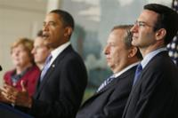 AP - Budget director Peter Orszag, right, looks on as President Barack Obama announces a new fee on big banks ...